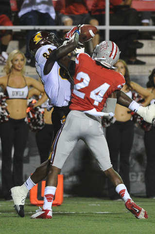 Central Michigan receiver Titus Davis (84) catches a 20-yard touchdown reception over UNLV defender Fred Wilson during a football game at Sam Boyd Stadium in Las Vegas Saturday, Sept. 14, 2013. (D ...