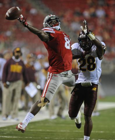 UNLV receiver Devante Davis (81) attempts to catch a pass over Central Michigan defender Dennis Nalor (28) during a football game at Sam Boyd Stadium in Las Vegas Saturday, Sept. 14, 2013. (David  ...