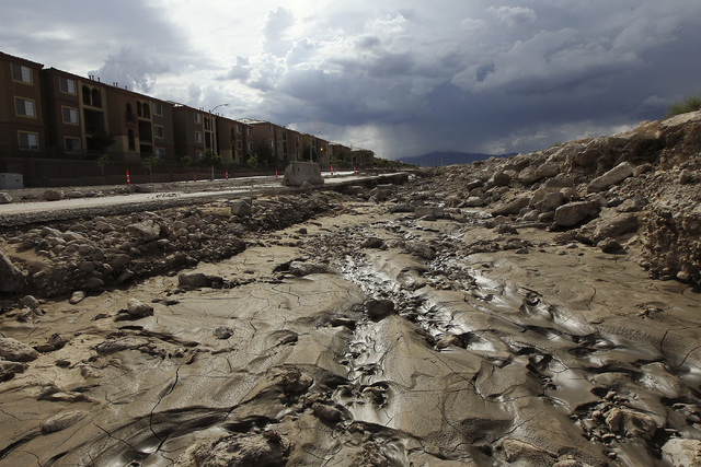 Flood damage is seen near the intersection of Grand Teton and Grand Canyon in Las Vegas on Sept. 4, 2013. (Jason Bean/Las Vegas Review-Journal)