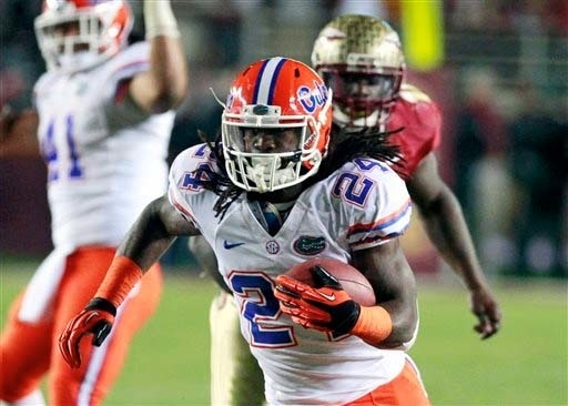 John Raoux/The Associated Press Florida running back Matt Jones runs against Florida State for a 32-yard touchdown during last season's game in Tallahassee, Fla.