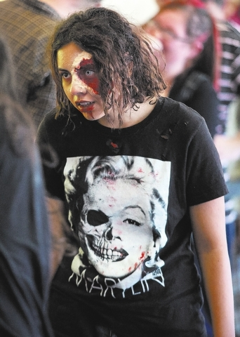 Fright Dome actor Britanny Guast walks around in makeup as applicants wait to be interviewed at Circus Circus.