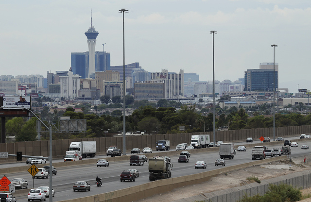 Traffic makes it's way on I-15 near downtown Las Vegas on Aug. 30, 2013. Clark County Commissioners have proposed a new gasoline tax.  (Jason Bean/Las Vegas Review-Journal)