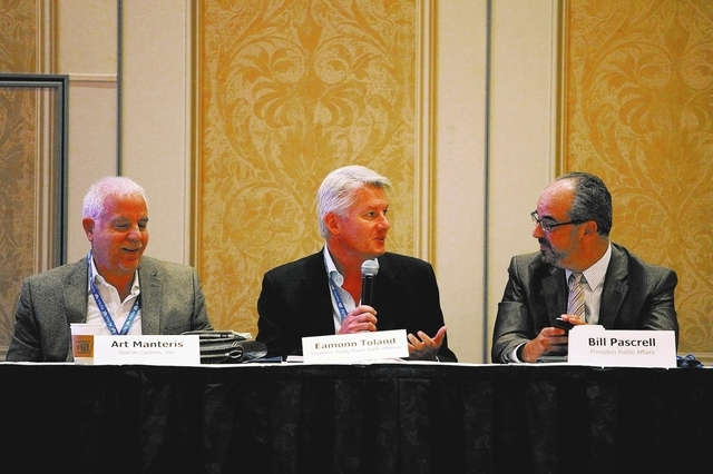 From left, Art Manteris with Station Casinos, Eamonn Toland with Paddy Power and Bill Pascrell with Princeton Public Affairs appear at a panel Tuesday at the G2E convention. (Jessica Ebelhar/Las V ...