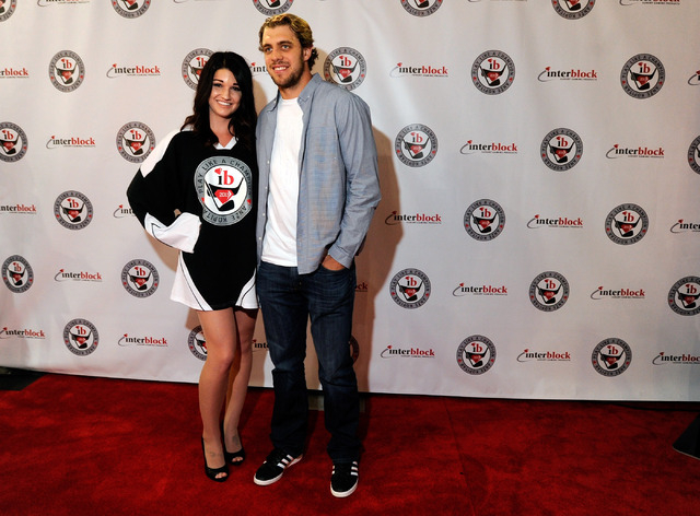 Anze Kopitar, right, of the Los Angeles Kings poses with Mandi O'Brien of Las Vegas during a meet and greet at the Interblock booth during G2E at the the Sands Expo and Convention Center on Wednes ...