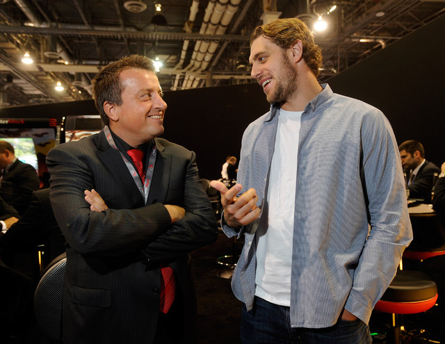 Anze Kopitar, right, of the Los Angeles Kings speaks with Joze Pececnik, chairman of the board of Interblock, during a meet and greet at the Interblock booth during G2E at the the Sands Expo and C ...