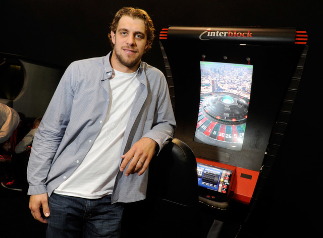 Hockey player Anze Kopitar of the Los Angeles Kings poses at the Interblock booth during G2E at the the Sands Expo and Convention Center on Wednesday. Kopitar is the spokesman for the Slovenian ga ...