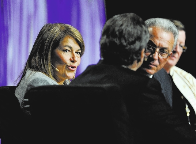 Holly Gagnon, left, president & CEO of Pearl River Resort, speaks during the State of the Industry Keynote at G2E at the Sands Expo and Convention Center on Wednesday, Sept. 25, 2013.  (David Beck ...