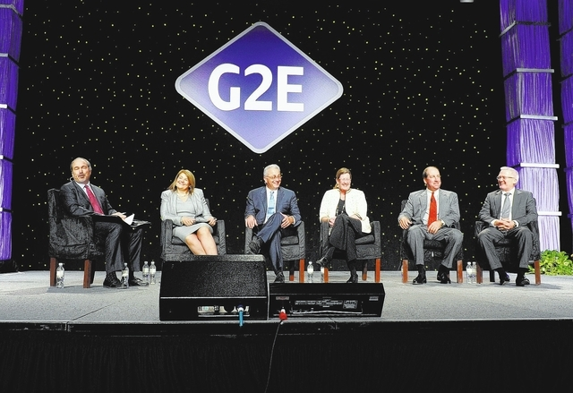 Moderator Jon Ralston, left, introduces member of the State of the Industry keynote address panel, from second left, Holly Gagnon, president & CEO of Pearl River Resort; Anthony Sanfilippo, presid ...