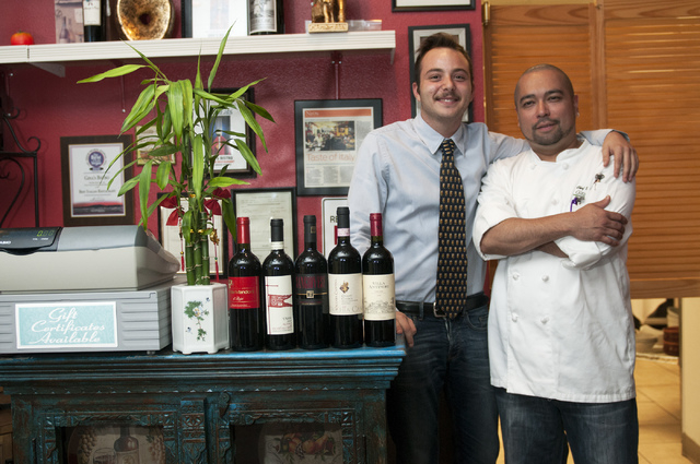 Riccardo Santamaria, left, and Sonny Santino, co-owners of Gina's Bistro, pose for a photograph at their restaurant, Saturday, Sept. 21, 2013, in Las Vegas, Nev. (Erik Verduzco/Las Vegas Review-Jo ...