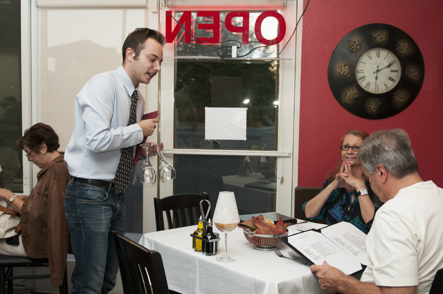 Riccardo Santamaria, left, co-owner of Gina's Bistro, is seen attending to customers during service, Saturday, Sept. 21, 2013, in Las Vegas, Nev. (Erik Verduzco/Las Vegas Review-Journal)