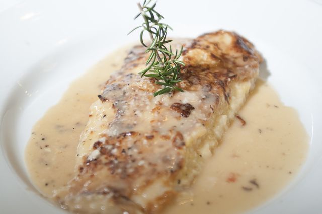 Gina's Bistro sogliola alla francese is seen served with a fillet of sole dipped in an egg battered pan, seared and served in a lemon butter sauce, Saturday, Sept. 21, 2013, in Las Vegas, Nev. (Er ...