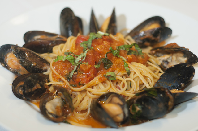 Gina's Bistro linguini al muscoli is seen served in a red sauce, with fresh tomato, basil and mussels, Saturday, Sept. 21, 2013, in Las Vegas, Nev. (Erik Verduzco/Las Vegas Review-Journal)