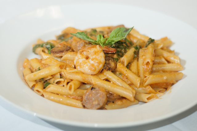 Gina's Bistro daily special is seen served with penne pasta, pink vodka sauce, sausage pancetta, spinach and fresh shrimp, Saturday, Sept. 21, 2013, in Las Vegas, Nev. (Erik Verduzco/Las Vegas Rev ...