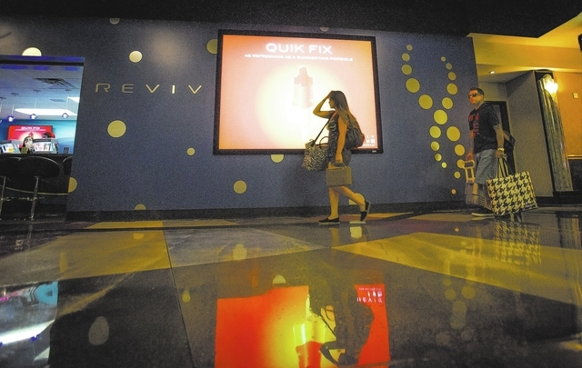 A woman walks pass REVIV in Underground at MGM Grand on Friday, Aug. 2, 2013. The store provides hangover and hydration remedies where guests are provided intravenous solutions that will be admini ...