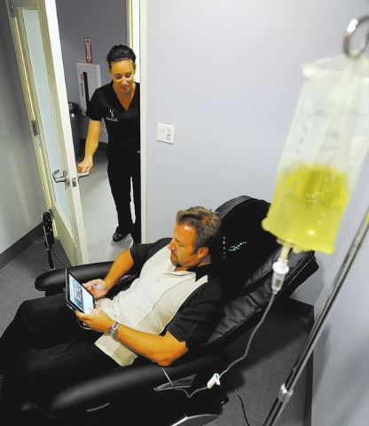 David Becker/Las Vegas Review-Journal  Nurse Krista Diaz checks in on Tom Kinzer as he receives the Royal Flush treatment at REVIV at MGM Grand. Kinzer, an MGM employee, wanted to try the newly op ...