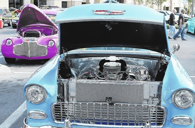 A blue 1995 Chevy Bel Air owned by Skip Wright and a purple 1941 Chevy Coupe owned by Don Vincent are displayed during Henderson's SuperRun Classic Car Show in September 2008 at The District at Gr ...