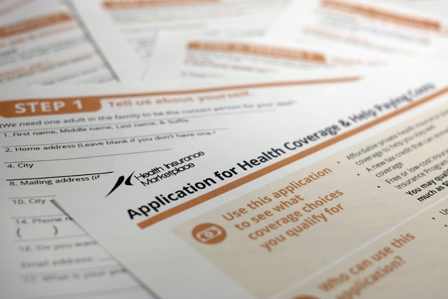 The federal government form for applying for health coverage. (AP Photo/J. David Ake)