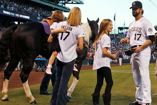 After being given a gelding paint horse  as a retirement present, Colorado Rockies first baseman Todd Helton, right, joins his daughter Tierney Faith, second from right, and his wife Christy and d ...