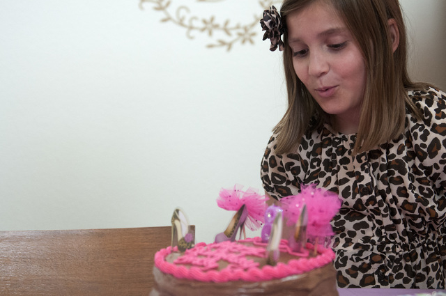 Emily Bartko, 8, blows out the candles of her cake during her birthday celebration at her home, Saturday, Sept. 7, 2013, in Las Vegas, Nev. Emily and her 4-month-old brother Aaron inherited Factor ...