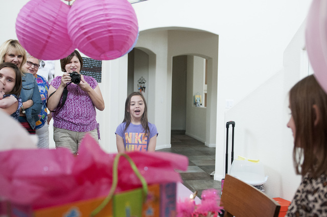 Emily Bartko, 8, is photographed by her family during her birthday celebration at their home, Saturday, Sept. 7, 2013, in Las Vegas, Nev. Emily and her 4-month-old brother Aaron inherited Factor I ...
