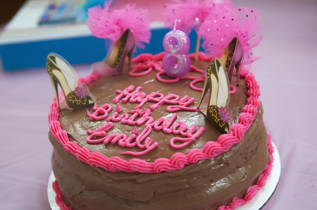 A birthday cake for Emily Bartko is seen during her birthday celebration at her family's home, Saturday, Sept. 7, 2013, in Las Vegas, Nev. Emily, 8, and her 4-month-old brother Aaron inherited Fac ...