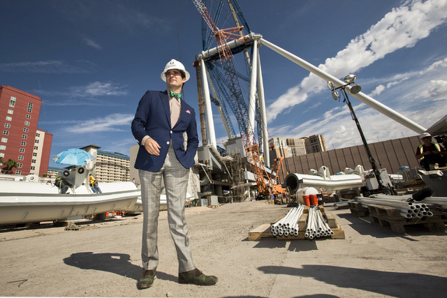 """Linq General Manager Jon Gray stands beside the High Roller Observation Wheel at The Linq on Aug. 23. """"We are creating an experience that drives people to want to visit us,"""" said Gray. (Jeff Schei ..."""