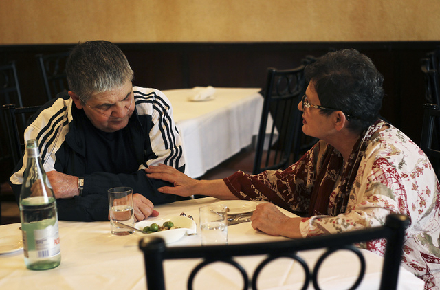 Nancy Vannucci, right, cares for her husband Robert during dinner at Nora's Italian Cuisine in Las Vegas on Tuesday. Robert, who is terminally ill, and his wife Nancy were being treated to dinner  ...