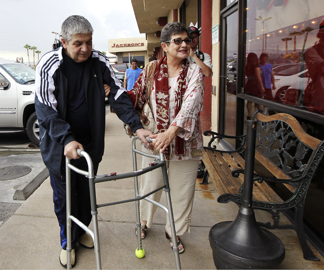 Nancy Vannucci, right, helps her husband Robert with his walker while arriving for dinner at Nora's Italian Cuisine in Las Vegas on Tuesday. Robert, who is terminally ill, and his wife Nancy were  ...
