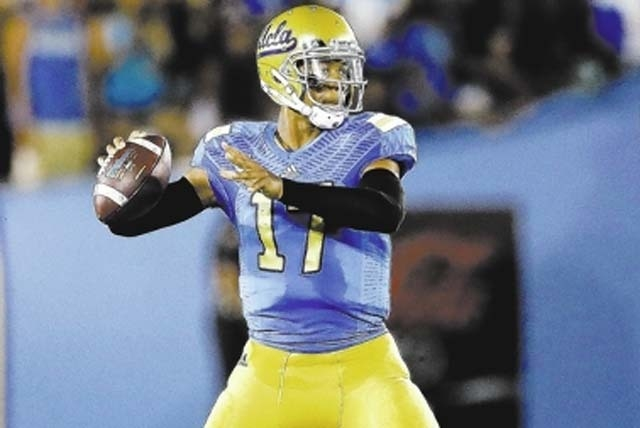 UCLA quarterback Brett Hundley throws against Nevada during the first half of an NCAA college football game in Pasadena, Calif., Saturday. (AP Photo/Chris Carlson)