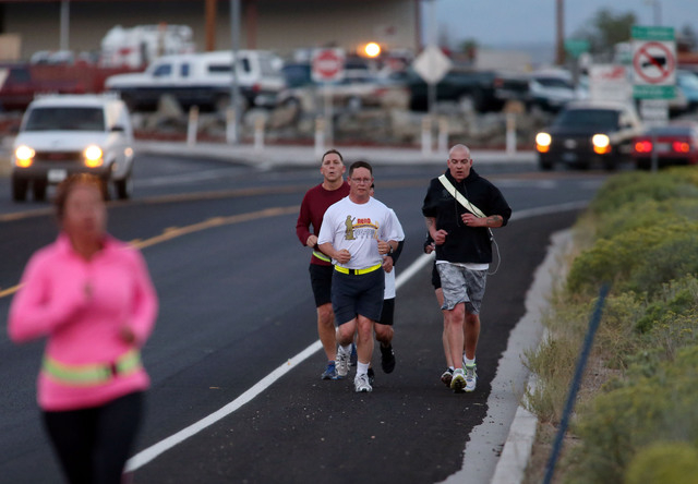 Col. Michael Hanifan, the incoming commander of the Nevada National Guard, in white, and Sgt. 1st Class Jeremy Mock, in black, were among approximately 50 people who participated in a memorial 5K  ...