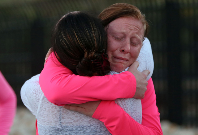 Savannah McCarthy, right, hugs Tracy Kelly after completing a memorial 5K walk and run in honor of the victims of the 2011 IHOP shooting in Carson City, Nev., on Friday, Sept. 6, 2013.  Kelly is t ...