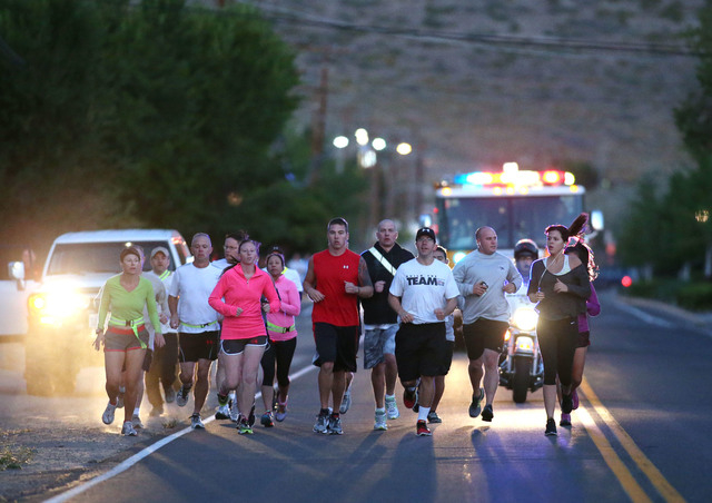 About 50 people participated in a memorial 5K walk and run in honor of the victims of the 2011 IHOP shooting in Carson City, Nev., on Friday, Sept. 6, 2013. (Cathleen Allison/Las Vegas Review-Journal)