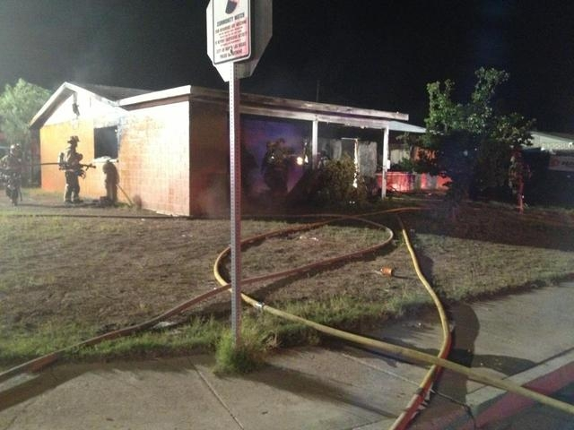 A vacant house at 2120 Hassell Ave. in North Las Vegas was heavily damaged by fire Thursday night. (Courtesy/North Las Vegas Fire Department)