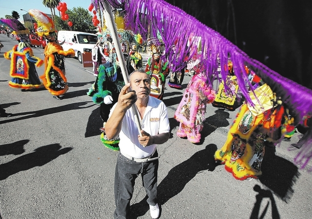Juan Mendoza, of Las Vegas, waves a flag during the Fiesta Las Vegas Latino Parade downtown on Saturday, Sept. 15, 2012. Mendoza originally from Morelos, Mexico was dancing with the Comparza Morel ...