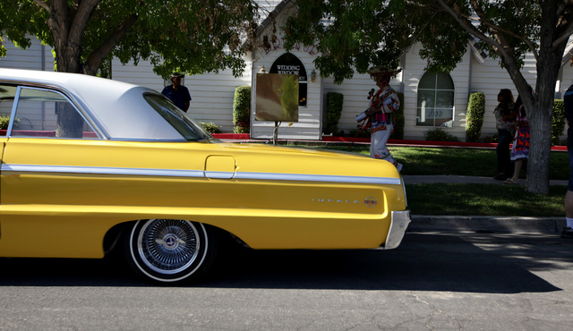 A yellow Chevrolet Impala waits parked for the start of the Fiesta Las Vegas Latino Parade downtown on Saturday, Sept. 15, 2012. The car was owned by a member of the La Familia car club in Los Ang ...