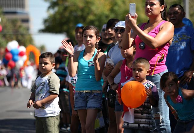 Fans watch the Fiesta Las Vegas Latino Parade downtown on Saturday, Sept. 15, 2012. (Justin Yurkanin/Las Vegas Review-Journal).