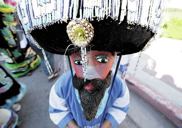 A Chinelos dancer waits for the start of the Fiesta Las Vegas Latino Parade downtown on Saturday, Sept. 15, 2012. Chinelos dancers originate from the state of Morelos in Mexico and came about to m ...
