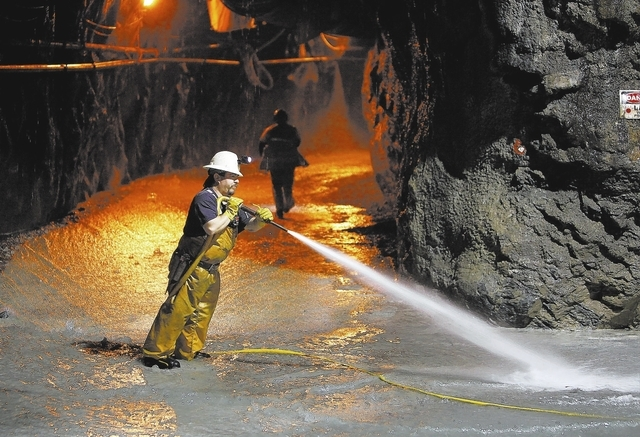 Jackie Triviso works in a tunnel roughly 400 feet below ground at Lake Mead near Las Vegas Wednesday, June. 12, 2013. The Southern Nevada Water Authority will use the tunnel to link a third intake ...