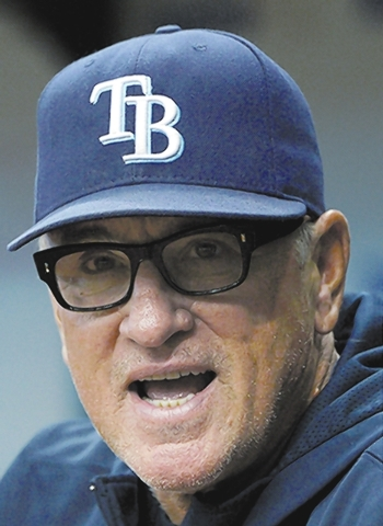 Tampa Bay Rays manager Joe Maddon, right, watches from the dugout during the first inning of a baseball game against the Toronto Blue Jays in St. Petersburg, Fla., Saturday, Aug. 17, 2013. (AP Pho ...