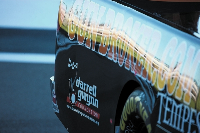 A sign for the Darrell Gwynn Foundation is seen on the car of Joey Coulter, who raises money for the foundation, before the start of the Smith's 350 NASCAR Camping World Truck Series at the Las Ve ...