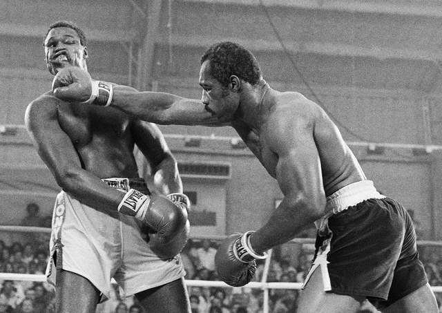 In this June 9, 1978, file photo, Ken Norton, right, and Larry Holmes battle for the WBC heavyweight championship at Caesars Palace in Las Vegas. Holmes won the bout in a 15-round split decision.  ...