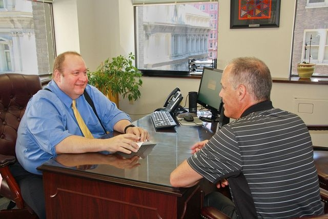 Ken Stevenson speaks with a candidate about changes in technology. Stevenson is senior lead technical recruiter/account manager at St. Louis' NextGen Information Services Inc. (Christy Hersc ...