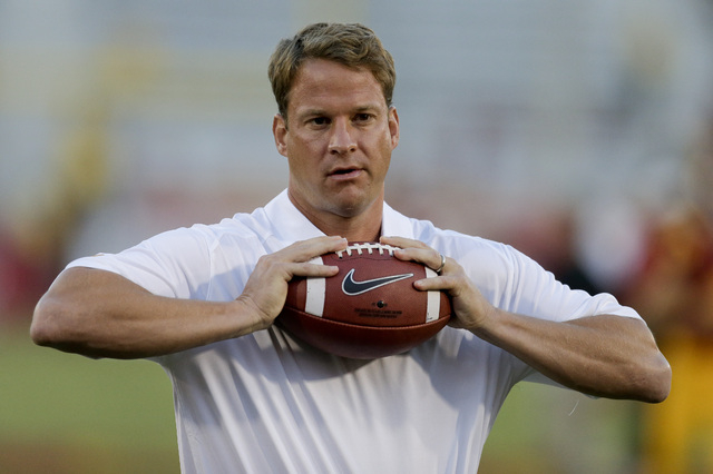 Southern California coach Lane Kiffin watches his team warm up for an NCAA college football game against Washington State in Los Angeles, Saturday, Sept. 7, 2013. (AP Photo/Chris Carlson)