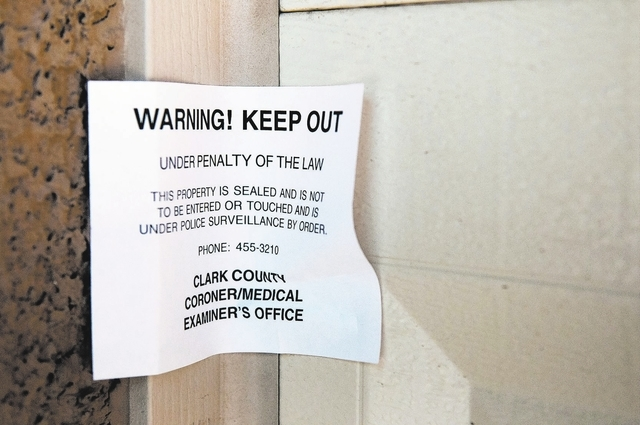 A note from the Clark County Coroner's office warns people to keep out of the home at 5695 Thunder Spirit St. in Las Vegas, Nev., Friday, Sept. 13, 2013. The bodies of Megan Kathleen Lanza and Nic ...