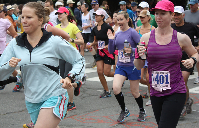courtesy photo Brittany O'Dale, center, waves to the camera as she competes in The Dipsea Race in California in June 2013. The Dipsea is the longest running trail race in the United States.  ...
