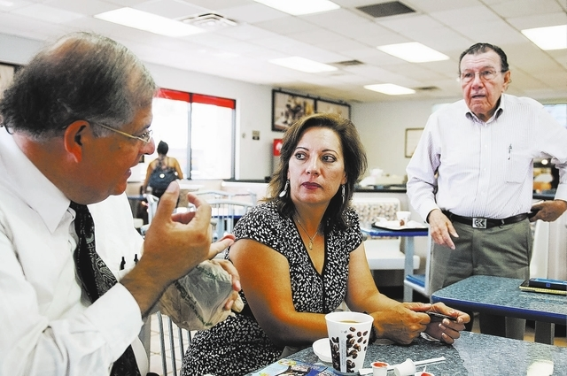 Erik Verduzco/Las Vegas Review-Journal  Fermin Ramirez, left, Margarita Chaidez and Humberto Pena, volunteer coordinators for Mexico Presente in Nevada, talk Aug. 21 about their involvement in Mex ...