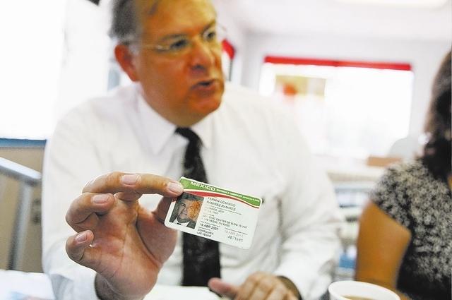 Erik Verduzco/Las Vegas Review-Journal  Fermin Ramirez, a volunteer coordinator for Mexico Presente in Nevada, shows his Mexican consulate identification card at a meeting Aug. 21 in Las Vegas. Ra ...