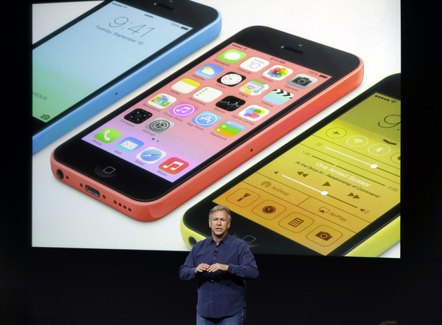 Phil Schiller, Apple's senior vice president of worldwide product marketing, speaks on stage during the introduction of the new iPhone 5c in Cupertino, Calif., Sept. 10. (AP Photo/Marcio Jose Sanchez)