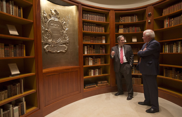 This photo taken Tuesday, Sept. 24, 2013 shows Doug Bradbrun, founding director of the Fred W. Smith National Library for the Study of George Washington, left, talking with Curt Viebranz, presiden ...