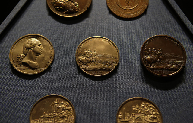 This photo taken Tuesday, Sept. 24, 2013 shows commemorate medals from the late 1700's that are part of the collection at the new Fred W. Smith National Library for the Study of George Washington  ...
